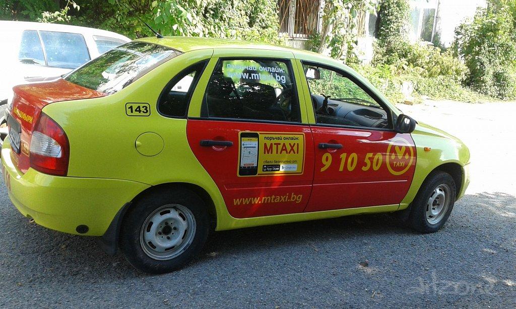 Облепване на такси с фолио за  Мтакси